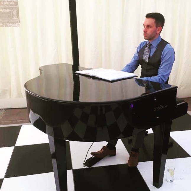 Craig Smith playing piano at Inn at Whitewell marquee wedding breakfast